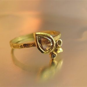 14k yellow solid gold ring with 0.56ct Diamond.